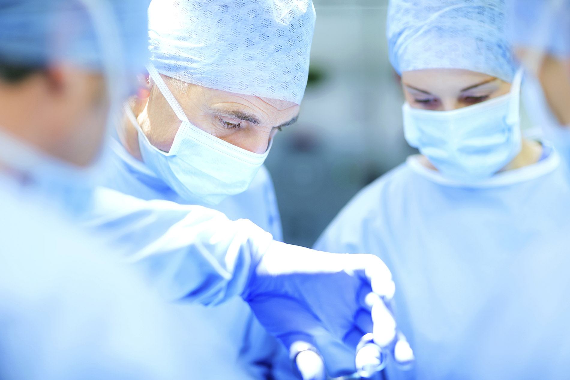 Team Of Surgeons Performing Surgery In Operating Room