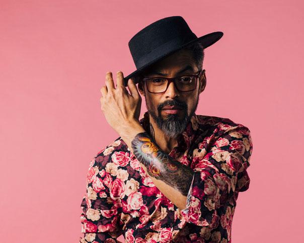 Fashionable tattooed man wearing a hat