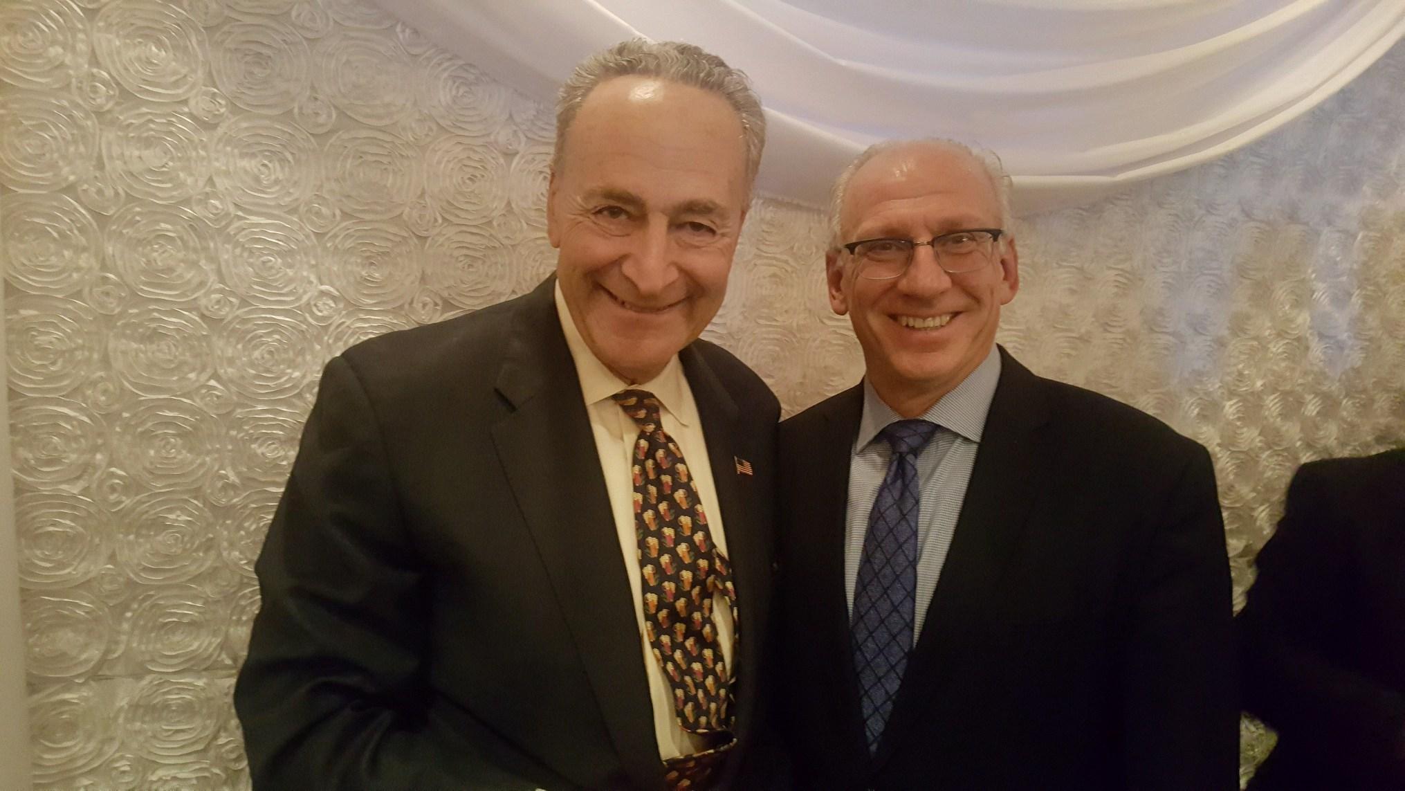 Davidoff Hutcher and Citron attorney Arthur Goldstein with Chuck Schumer